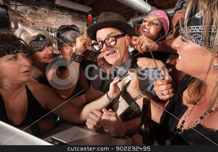 Nervous Nerd with Tough Women stock photo, Nervous male nerd with group of intimidating biker gang women by Scott Griessel