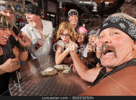 Tough Man Arm Wrestling Nerd stock photo, Tough man reacting in arm wrestling match with female nerd by Scott Griessel