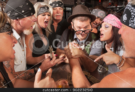 Nerd Beats Biker in Arm Wrestling stock photo, Nerd winning an arm wrestling match with strong biker  by Scott Griessel