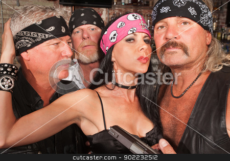 Sexy Biker Woman with Boyfriends stock photo, Sexy mature white female with three biker gang boyfriends by Scott Griessel