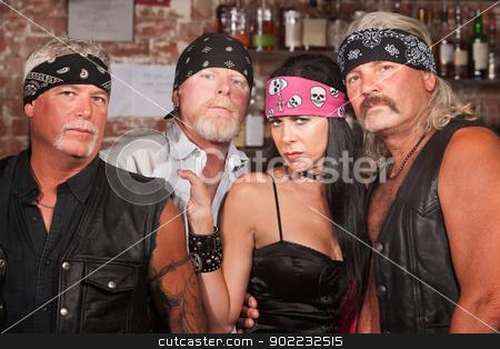 Biker Gang Members with Woman stock photo, Tough male biker gang members with beautiful woman by Scott Griessel