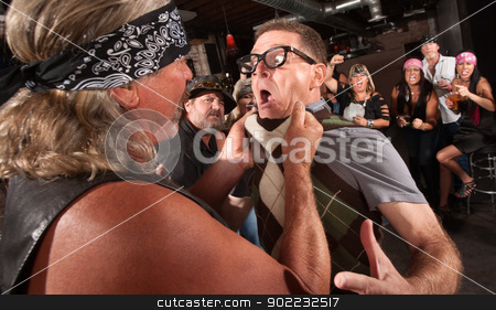 Gang Member Grabs Nerd stock photo, Nerd grabbed by collar in bar fight with tough gang member by Scott Griessel