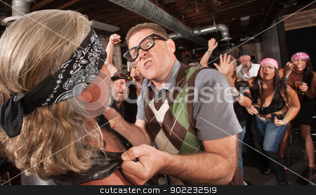 Mad Nerd Fighting Back stock photo, Outraged nerd grabbing gang member by the jacket in bar by Scott Griessel