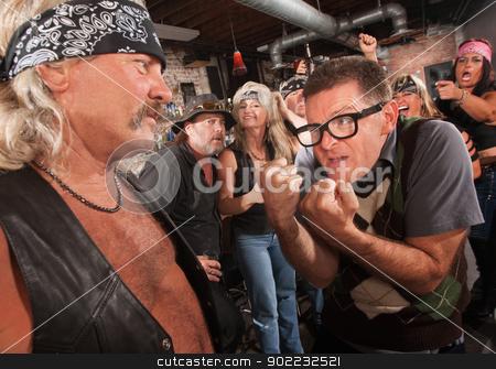 Nerd Confronting Gang Member stock photo, Nerd confronting tough gang member in leather vest in bar by Scott Griessel