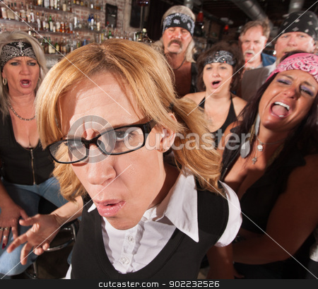Annoyed Nerd with Laughing Gang stock photo, Annoyed Caucasian female nerd with laughing motorcycle gang behind her by Scott Griessel