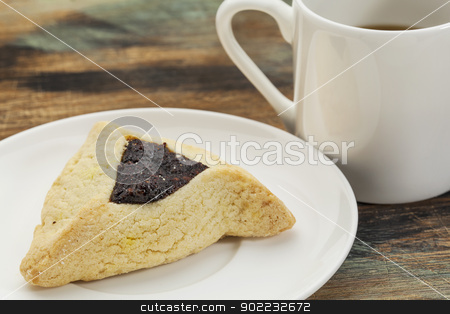 hamantaschen cookie stock photo, fruit hamantaschen cookie  on a plate with a cup of coffee - a traditional pastry in Ashkenazi Jewish cuisine for holiday of Purim by Marek Uliasz