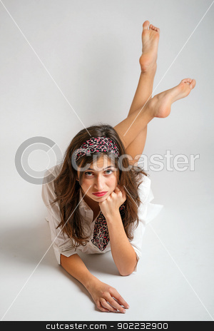 Woman lying o floor  stock photo, Portrait of young woman lying o floor  by Grafvision