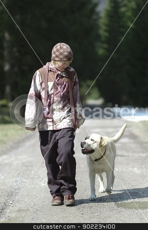 Young boy with dog stock photo, Young boy handling his dog on walking through the forest by Michael Jenewein