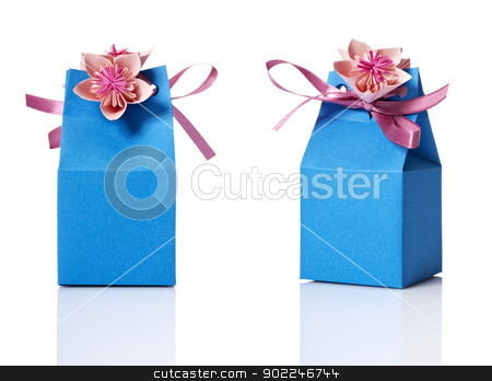 Gift box stock photo, Studio shot of small gift box with decoration. Box isolated on white background. by Filip Warulik