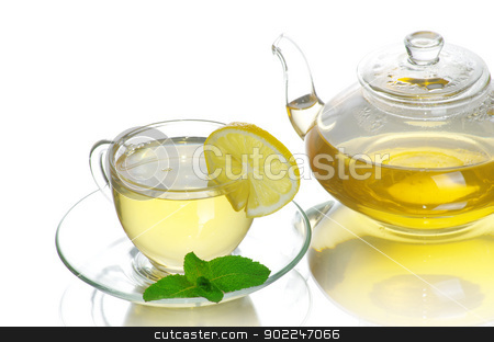  tea cup stock photo, Tea being poured into glass tea cup by Vitaliy Pakhnyushchyy