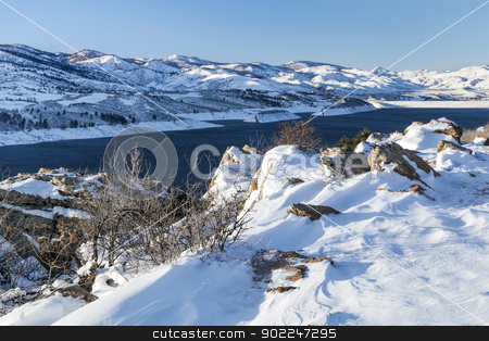 mountain reservoir and dam stock photo, snow covered trail - Horsetooth Reservoir and dam at Rocky Mountains foothills near Fort Collins, Colorado, winter scenery by Marek Uliasz