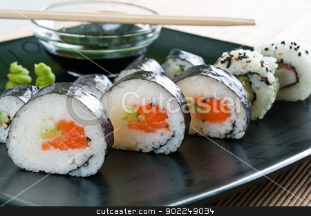 Japanese Sushi stock photo, Selection of japanese sushi arranged on black plate by Rafal Stachura