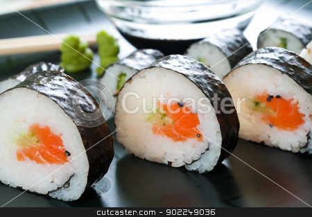 Japanese Sushi stock photo, Selection of japanese sushi arranged on black plate by Tiramisu Studio