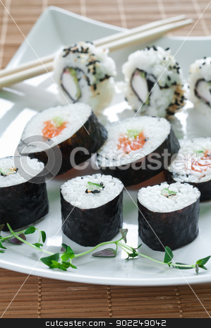 Japanese Sushi stock photo, Selection of japanese sushi arranged with thyme on white plate by Tiramisu Studio
