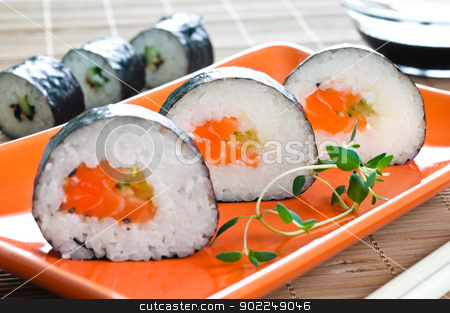 Japanese Sushi stock photo, Selection of Japanese sushi arranged with thyme on red plate by Tiramisu Studio