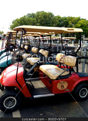 Golf carts lined up stock photo, Golf carts lined up by Liane Harrold