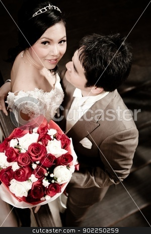 Groom looking at bride stock photo, Groom looking at bride by Vichaya Kiatying-Angsulee