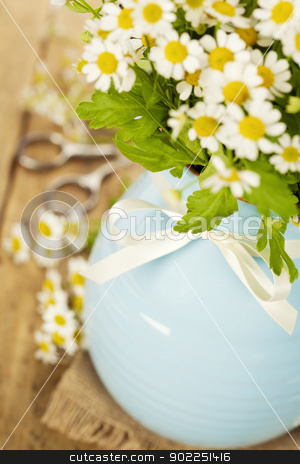 flowers in a vase stock photo, Beautiful flowers in a vase on an old table by klenova