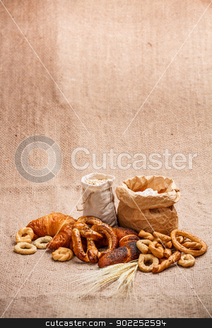 Composition of various baked products stock photo, Composition of various baked products in basket on rustic background  by Grafvision