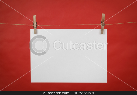 Memory note white paper hanging on cord stock photo, Memory note white paper hanging on cord on red background by Artush