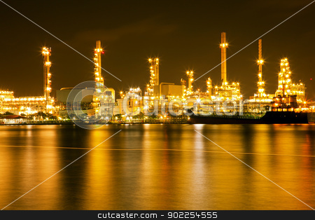 Oil refinery plant stock photo, Oil refinery plant shines at night along river by Vichaya Kiatying-Angsulee