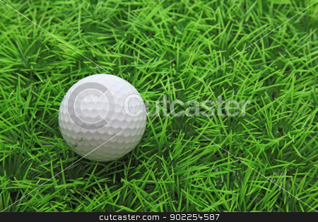 closeup of golf ball on green grass stock photo, closeup of golf ball on green grass by Vichaya Kiatying-Angsulee