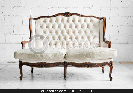 sofa in vintage room stock photo, White genuine leather classical style sofa in vintage room by Vichaya Kiatying-Angsulee
