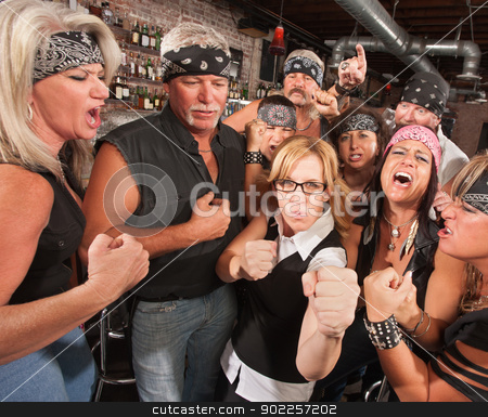 Nerd Holds Up Fists with Gang in Bar stock photo, Motorcycle gang and female nerd holding up fists in bar by Scott Griessel