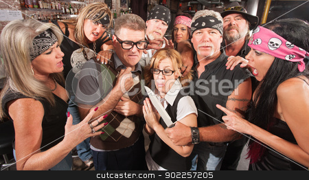 Nerd Couple Robbed by Gang stock photo, Motorcycle gang robbing Caucasian nerd couple in bar by Scott Griessel