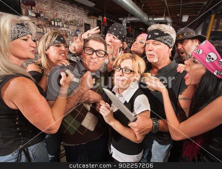 Thugs Teasing Nerds stock photo, Group of thugs teasing nerds in a bar by Scott Griessel