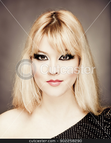 Beautiful young woman stock photo, Close-up portrait of a young and beautiful blonde woman by ikostudio