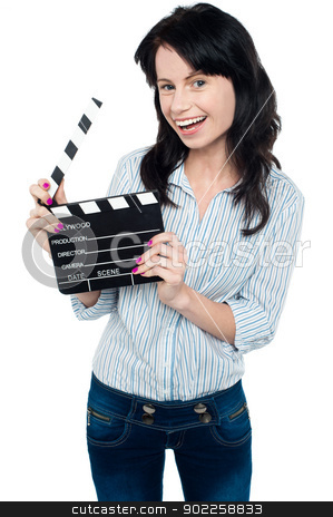 Joyous woman with clapperboard stock photo, Beautiful young brunette in trendy wear posing with clapperboard. by Ishay Botbol