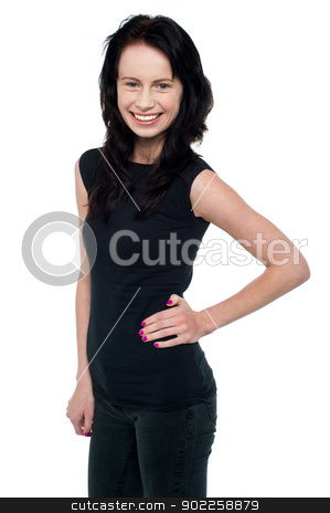 Pretty smiling female model posing casually stock photo, Casual portrait of young smiling woman isolated against white background. by Ishay Botbol