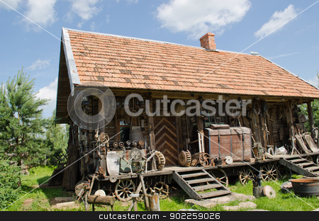 different retro rural tools old wooden log house  stock photo, various different retro rural tools near old wooden log house.  by sauletas