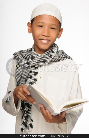 Muslim Boy stock photo, A muslim boy wearing islamic attire by Hasnuddin Abu Samah