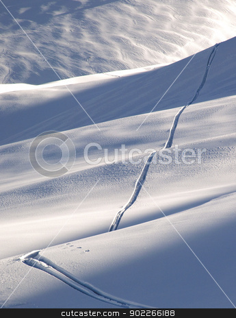 Off-piste ski track stock photo, Off-piste ski track in sunset light by Krzysztof Nahlik