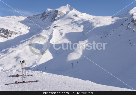 Skis and Hintertux Glacier stock photo, Two pairs of skis, ski lifts and pistes and Hintertux Glacier in Zillertal Alps in Austria at sunset light by Krzysztof Nahlik