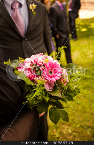 bouquet stock photo, man holding flower bouquet by Axel Lauer