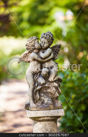statue stock photo, stone staue of two little putti kissing by Axel Lauer