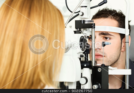 medical attendance at the optometrist stock photo, Male patient is having a medical attendance at the optometrist by iMarin