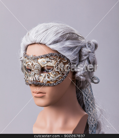 Venetian mask stock photo, Venetian mask on a mannequin in front of a light background by Axel Lauer