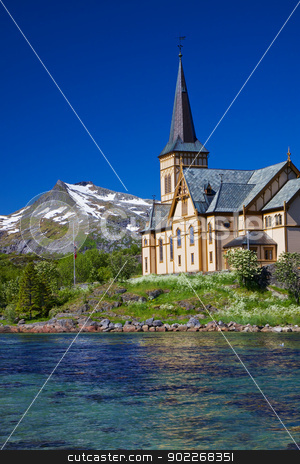 Lofoten cathedral in Norway stock photo, Picturesque Lofoten cathedral on Lofoten islands in Norway with snowy peaks in the background by Harvepino