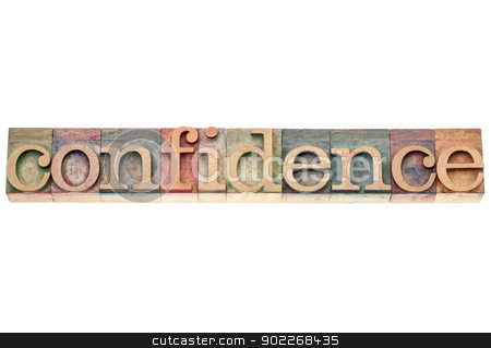 confidence word in wood type stock photo, confidence word  - isolated text in vintage letterpress wood type printing blocks by Marek Uliasz