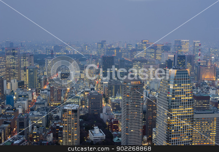 Tokyo at night stock photo, View of the sprawling metropolis of Tokyo, Japan at dusk with illuminated tall modern skyscrapers and buildings by Stephen Gibson