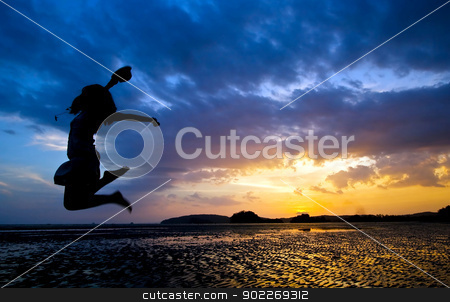 jumper at beach sunset stock photo, Funny time in dusk at Phranang Beach near Phuket Thailand by Vichaya Kiatying-Angsulee