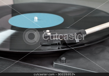Vintage record player with spinning vinyl. Motion blur image.  stock photo, Detail of vintage record player with spinning vinyl. Motion blur image.  by Artush