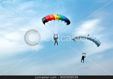 unidentified skydivers on blue sky stock photo, two silhouettes of unidentified skydivers on blue sky by Artush