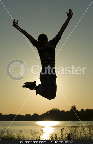 guy in jump stock photo, Young guy in jump on background dark  sky        by Vitaliy Pakhnyushchyy
