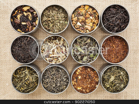 green, white, black and herbal tea stock photo, samples of loose leaf green, white, black and herbal tea in metal cans on canvas background by Marek Uliasz