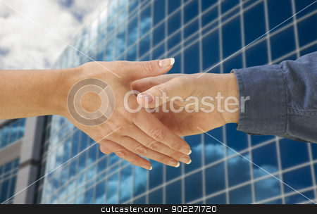 Man and Woman Shaking Hands In Front of Building stock photo, Man and Woman Shaking Hands In Front of Corporate Building Background. by Andy Dean